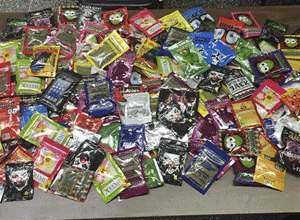 This photo provided Friday, Aug. 7, 2015 by New York Police Department shows packets of synthetic marijuana seized after a search warrant was served at a newsstand in Brooklyn, N.Y.
