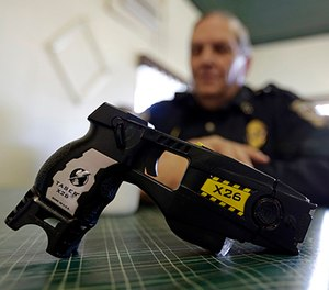 This Nov. 14, 2013, file photo, shows a Taser X26 on display.