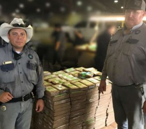 Two sergeants found cocaine in a fruit shipment that led to the discovery of 540 packages of cocaine hidden in the boxes.
