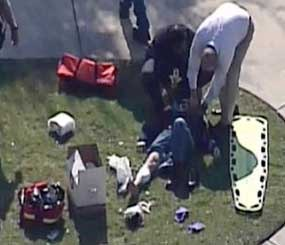 In this frame grab provided by KPRC Houston, an unidentified person is attended to by emergency personnel at Lone Star College Tuesday, Jan. 22, 2013, in Houston, where law enforcement officials say the community college is on lockdown amid reports of a shooter on campus.  (AP Image)