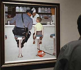 Visitors at The Norman Rockwell Museum in Stockbridge, Mass., view the 1958 paintings