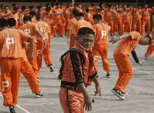 Inmates at the Cebu Provincial Detention and Rehabilitation Center on the island province of Cebu in central Philippines dance to the late Michael Jackson's
