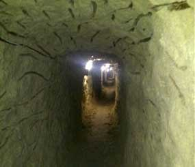 This image provided Thursday July 12, 2012, by the U.S. Immigration and Customs Enforcement shows a tunnel discovered by authorities designed to smuggle drugs into the United States, found in Tijuana, Mexico. (AP Photo/ICE)