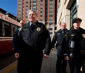 This photo shows University of Maryland Police Chief David Mitchell, second from left, and UMPD Police Officers, from left, Mike Weller, Robert Jenshoej, and Sgt. Rosanne Hoaas, walking on a sidewalk at the extended jurisdiction area of the University of Maryland in College Park.