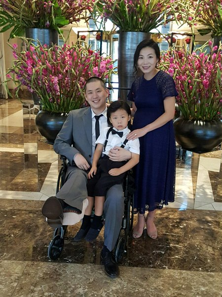 An with his wife and 4-year-old son.