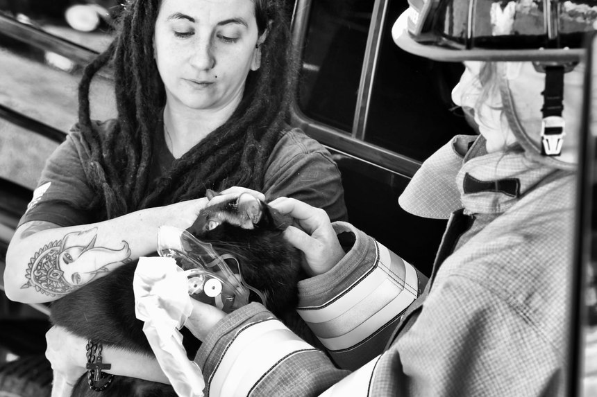 Chesterfield Firefighter-EMT Amie Barnes (right) administers oxygen to a cat suffering from smoke inhalation after a house fire.
