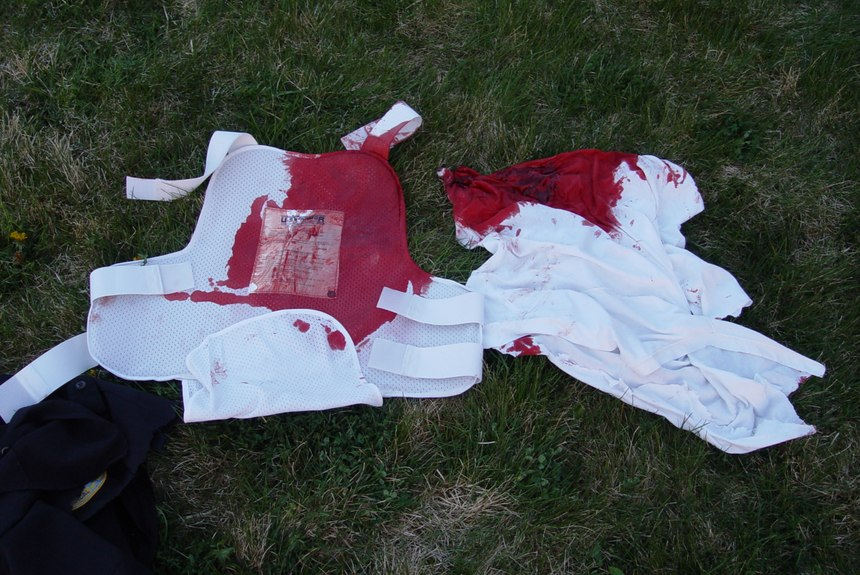 His blood-soaked vest shows how close Lt. Phil Murphy came to losing his life. (Photo/Miriam Murphy)