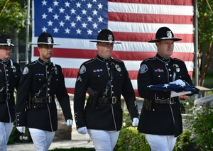 From left, Westminster PD Honor guards Sgt. Kevin MacCormick, Officer Kees Davis, Cpl. Jeremy Fletcher and Investigator James Delk at an annual ceremony honoring the three WPD fallen officers currently named on the memorial.