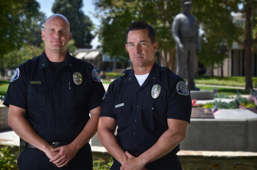 Westminster PD Commanders Cord Vandergrift, left, and Darin Upstill are among several current and retired WPD officers lobbying to get Sgt. Tom Richard's name added to the Westminster Police Department Memorial.