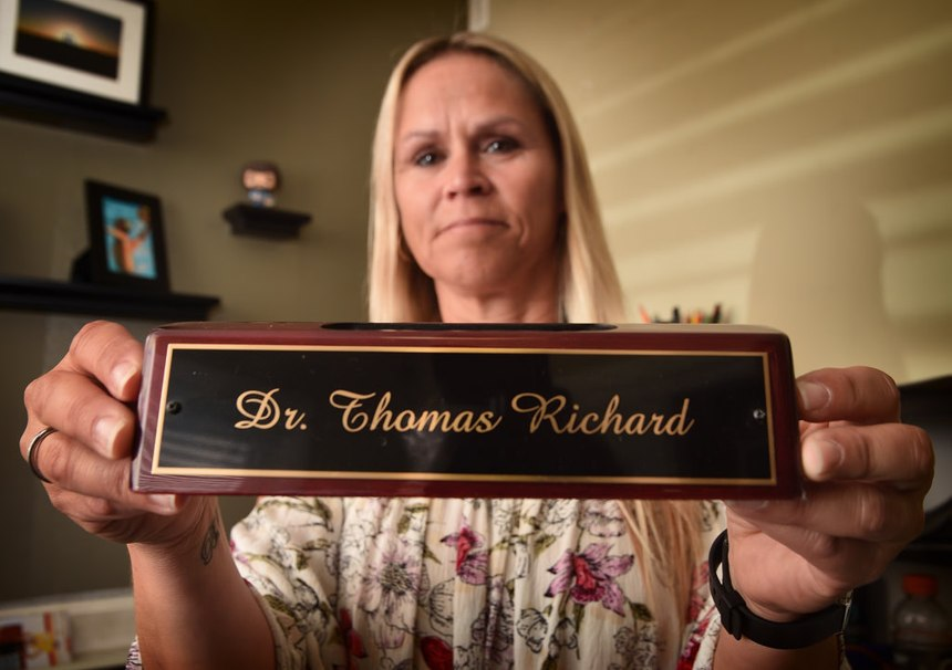 Carrie Richard holds her late husband's nameplate, which would end up being her last Christmas gift to him. Tom earned a doctorate in psychology and was planning on opening a practice with two other retired peace officers to help cops suffering from PTSD and other mental illnesses.