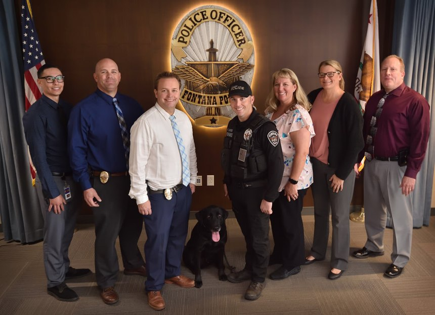 Members of the Fontana PD's Internet Crimes Against Children (ICAC) detail are, from left, Computer Forensics Technician Brandon Canary, Corp. Brad Guith, Det. Justin Moyer, K9 Officer Mark Wyrick with K9 Officer Goose, Det. Heidi Kouroubacalis, Det. Vanessa Waggoner, and Sgt. Darren Robbins. (Photo/Steven Georges/Behind the Badge)