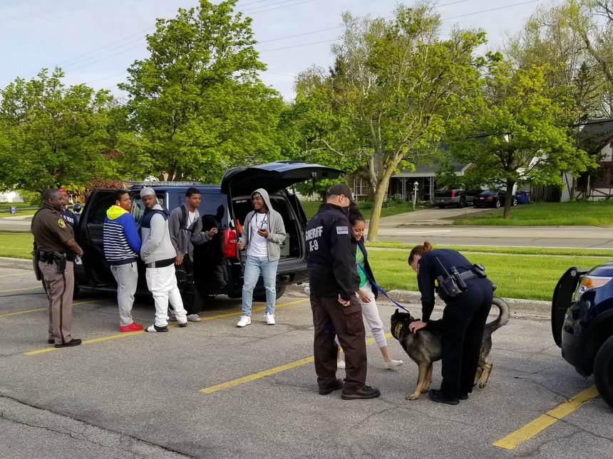 Part of the School Emergency Response Coalition's Career Day includes working with a K9 unit.