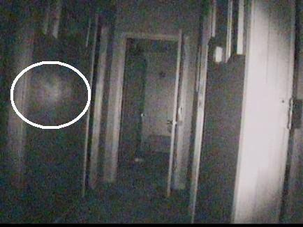 A still image from a Paranormal 911 investigation shows a mysterious orb.