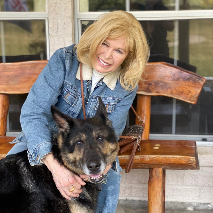 M.A.S.H. star Loretta Swit visited the Mission K9 Rescue Veteran K9 Ranch and loved all the dogs. She is pictured here with contractor working dog Deny from Kuwait.