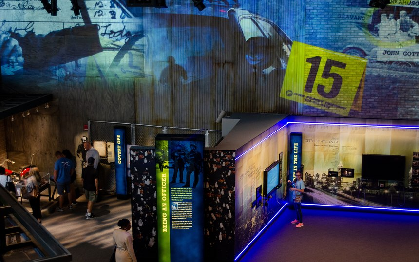 Exhibits at the National Law Enforcement Museum offer visitors the chance to see what it is like to be a bomb tech, a K9 officer, SWAT officer and 911 dispatcher.