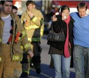 Firefighters and families gather at a staging area following the Sandy Hook shooting.