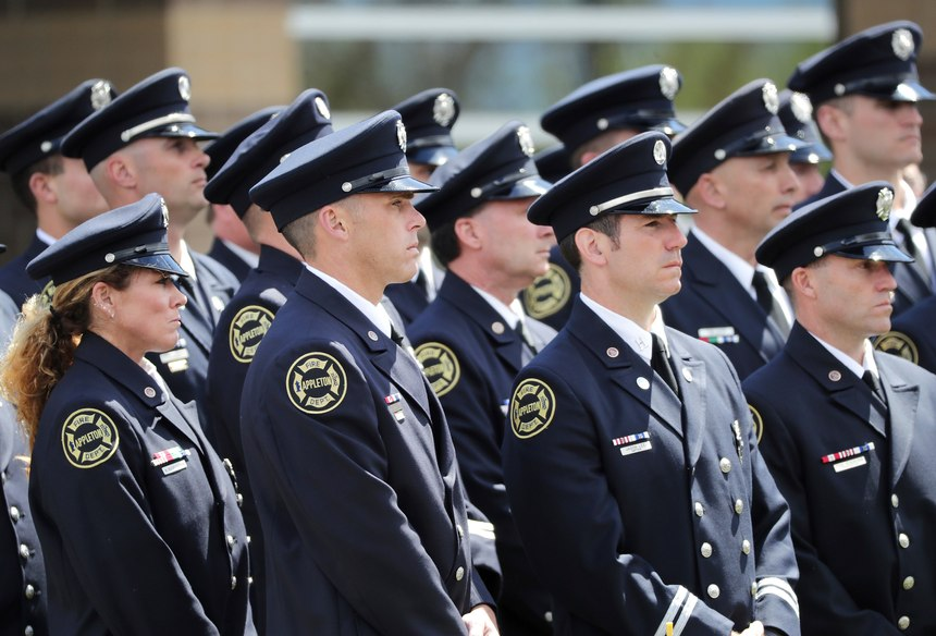 Firefighters attend the funeral for Appleton firefighter Mitchell F. Lundgaard, at the Appleton Alliance Church on Monday, May 20, 2019, in Grand Chute, Wis. The 14-year veteran of the Appleton Fire Department was fatally shot while responding to a medical emergency at the downtown Valley Transit Center on May 15, in Appleton, Wis.