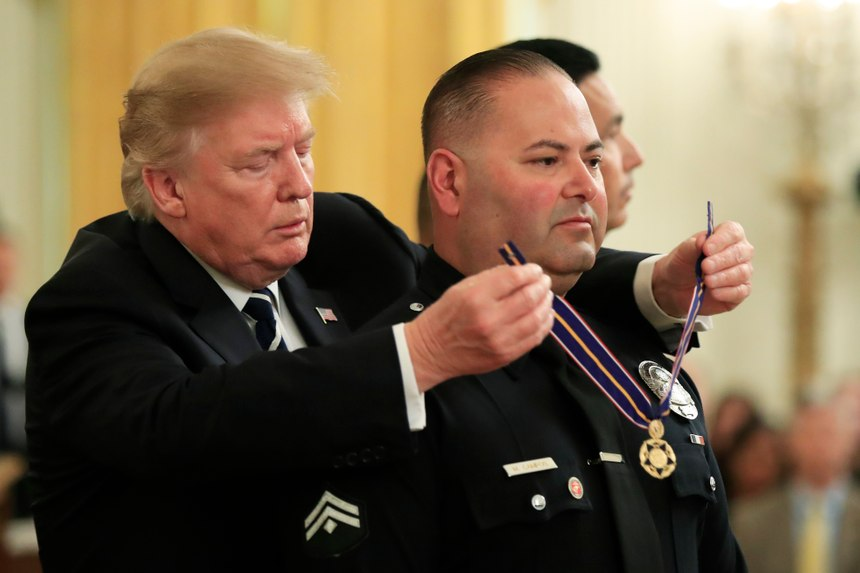 President Donald Trump awards Detective Manuel Campos of Irwindale (Calif.) Police Department, the Public Safety Officer Medal of Valor during a ceremony in the East Room of the White House in Washington, Wednesday, May 22, 2019. (AP Photo/Manuel Balce Ceneta)