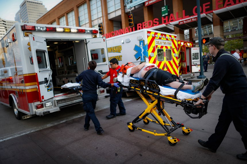 Emergency medical personnel prepare to load a simulated victim into an ambulance during a mass casualty training exercise, Thursday, Sept. 19, 2019, in Cincinnati. (AP Photo/John Minchillo)