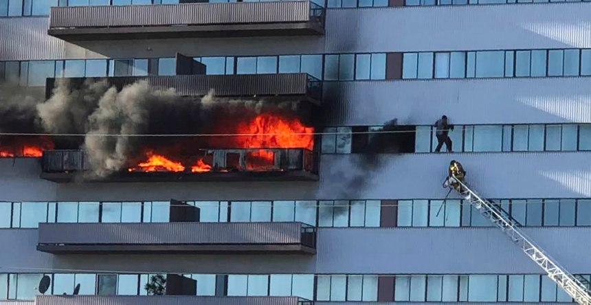 This image from video by Jenna Fabian shows a Los Angeles Fire Department firefighter on a ladder rescuing a man who had climbed out on the side of a 25-story high-rise apartment, escaping flames from a burning apartment balcony, after a fire broke out on a sixth-floor balcony and sent choking smoke billowing through the upper levels in West Los Angeles Wednesday, Jan. 29, 2020. (Photo/Courtesy of Jenna Fabian via AP)