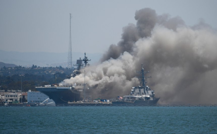 Smoke rises from the USS Bonhomme Richard at Naval Base San Diego after an explosion and fire Sunday on board the ship at Naval Base San Diego. (AP Photo/Denis Poroy)