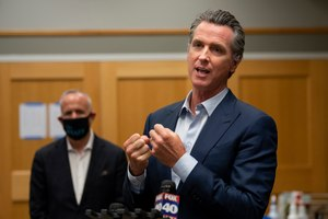 California Gov. Gavin Newsom speaks during a tour of a cooling center with Sacramento Mayor Darrell Steinberg at the Tsakopoulos Library Galleria onAug. 18, in Sacramento.