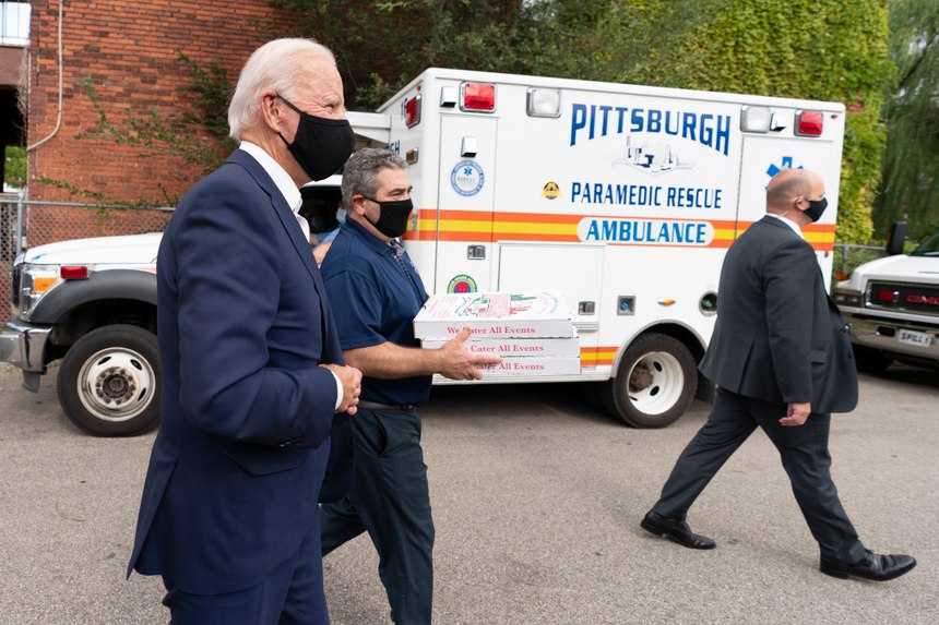 Democratic presidential nominee and former Vice President Joe Biden arrives with pizza as he visits Pittsburgh Fire Fighters IAFF Local No. 1 in Pittsburgh, Pa., Monday, Aug. 31, 2020. (AP Photo/Carolyn Kaster)