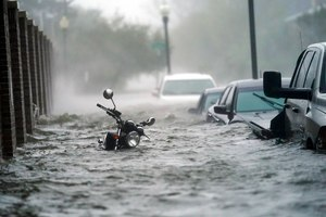 Cars and a motorcycle are are submerged in floodwaters on a street, Wednesday, Sept. 16, 2020, in Pensacola, Fla. Hurricane Sally made landfall Wednesday near Gulf Shores, Alabama, as a Category 2 storm, pushing a surge of ocean water onto the coast and dumping torrential rain that forecasters said would cause dangerous flooding from the Florida Panhandle to Mississippi and well inland in the days ahead.