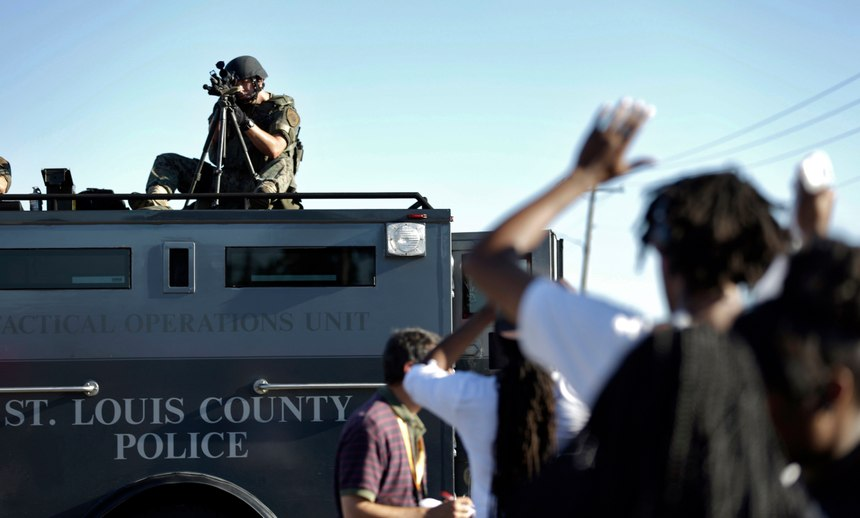 The Ferguson after-action report found that the overwatch tactic was inappropriate as a crowd control measure. (AP Photo/Jeff Roberson)