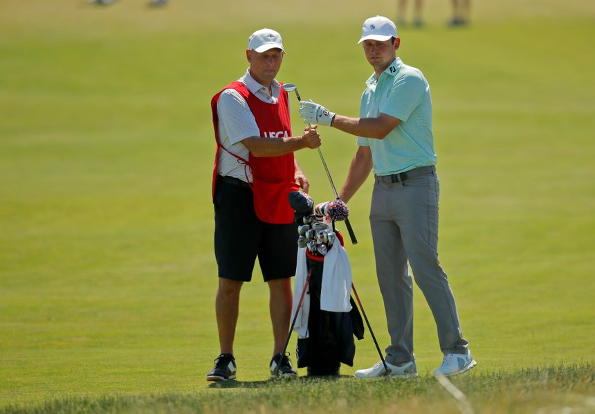 Matt Parziale, right, takes a club from his caddie and father, Vic Parziale, on the first fairway during the final round of the U.S. Open Golf Championship, Sunday, June 17, 2018, in Southampton, N.Y. (AP Photo/Carolyn Kaster)