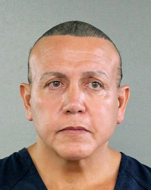 In this undated photo, Cesar Sayoc is seen in a booking photo, in Miami. (Broward County Sheriff via AP)