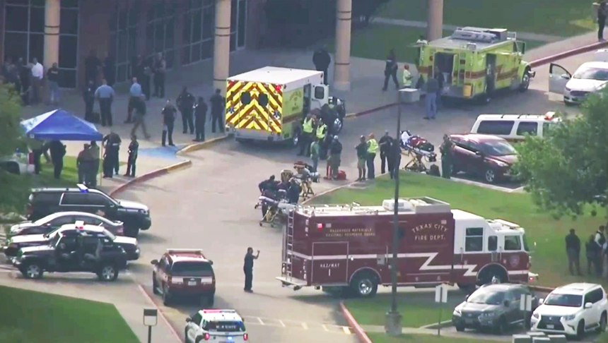 In this Friday, May 18, 2018 file image taken from video, emergency personnel and law enforcement officers respond to a high school near Houston after an active shooter was reported on campus, in Santa Fe, Texas.