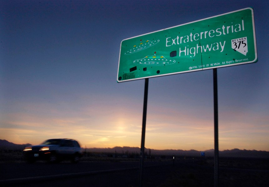 "A vehicle moves along the Extraterrestrial Highway near Rachel, Nevada, the closest town to Area 51. The U.S. Air Force has warned people against participating in an internet joke suggesting a large crowd of people ""storm Area 51,"" the top-secret Cold War test site in the Nevada desert. (AP Photo/Laura Rauch, File)"