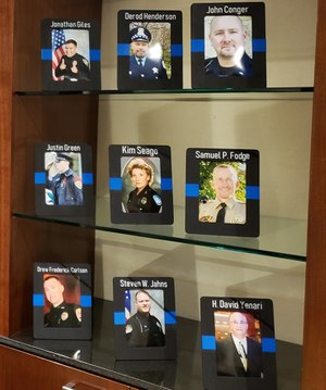 Photos of officers lost to suicide on display at the 2019 Blue H.E.L.P. Police Week event (Photo/Blue H.E.L.P.)
