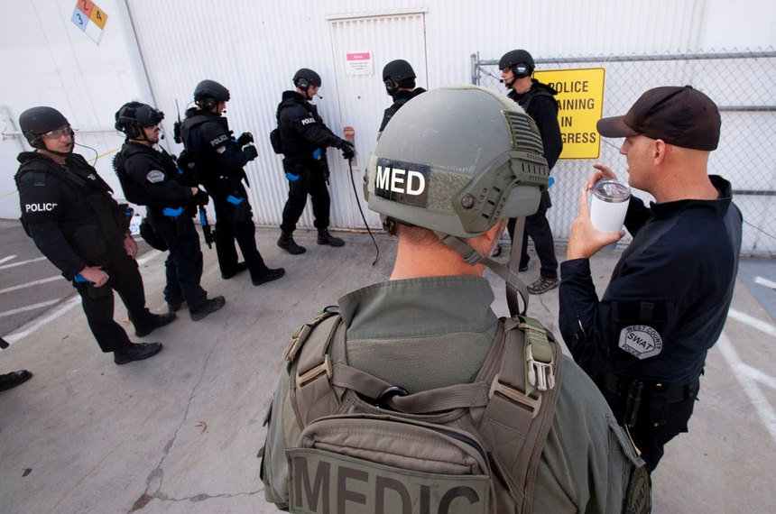 Dr. Joshua Bobko, right, walks back into a warehouse where West (Orange) County SWAT was holding a training exercise in Fountain Valley on Wednesday, October 16, 2019.
