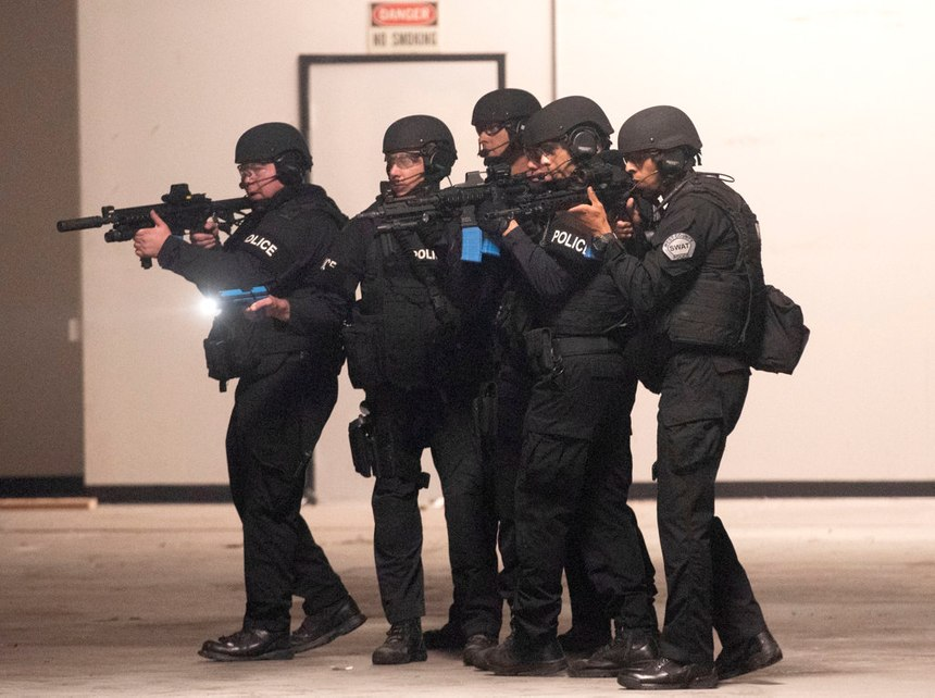 West (Orange) County SWAT officers run through a training exercise in Fountain Valley on Wednesday, Oct. 16, 2019.