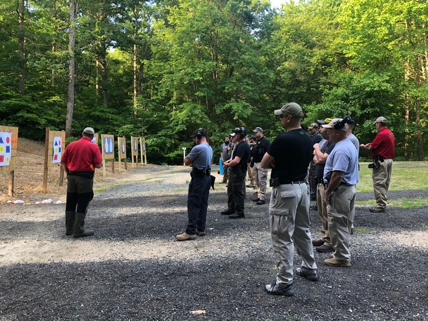During this Firearms Instructor Development class at the Rappahannock Regional Police Academy, co-instructor Lieutenant Weinstein from the Northern Virginia Community College PD discusses how to run a shoot/don't shoot drill using specialized targets.