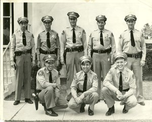 The author's grandfather, who served as a reserve police officer in California in the 1960s, is pictured kneeling, lower left.