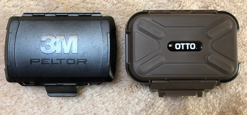Both cases snap closed to protect the earpieces. The Peltor case locks securely and needs to be opened by pressing up with two thumbs along the edge of the latch. The Otto case is easier to open but might open unintentionally.