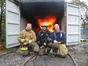 Left to right: Jason Caughey, Jim Mastin and Dr. John Culbertson, training at Lancashire Fire Rescue Service in England.