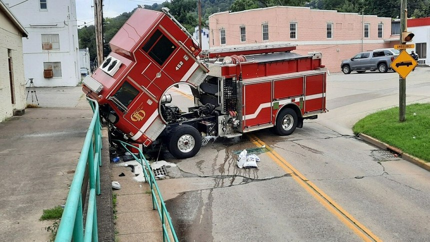 A Charleston Fire Department fire truck crashed, injuring a firefighter, when the spring brakes (parking brake) failed during the truck check, allowing the truck to roll forward. (Photo courtesy WCHS.com)
