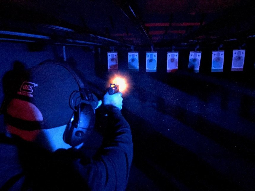 Shooting an RDS in the dark with red and blues flashing can have some interesting effects depending on the settings of your optic. (Photo courtesy Commander Paul Gregory)