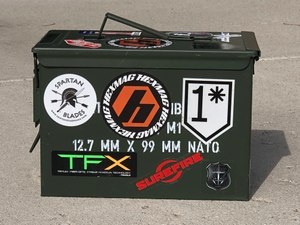 The ubiquitous ammo can was an inexpensive yet hardy form of Tupperware for my patrol car.  I had a few in different colors to help me quickly recall their contents. (Photo/Sean Curtis)