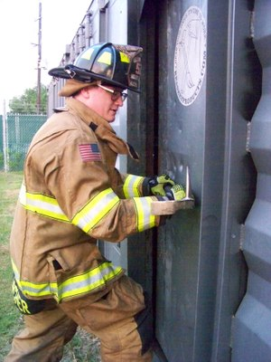 Figure 7: Force the adz and spike end of the Halligan toward the face of the door until entry is gained.