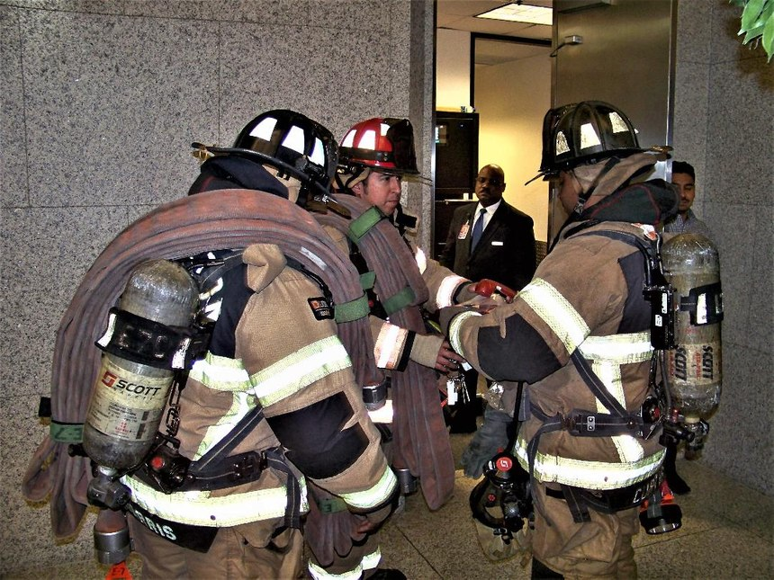 The initial attack team should report directly to the FCC to receive the necessary equipment provided by Lobby Control. Here, is also where face-to-face communications and updates as well as other information is passed on before ascending in the elevator or taking the stairs.