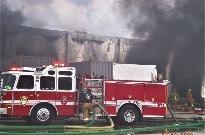 Large overhead doors will offer the best ventilation effects during initial stages of operations and should be the primary focus prior to any interior attack efforts.(Photo/DC Mike Phillips)
