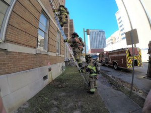 When conducting VEIS via a second-floor window, the search firefighter should proceed up the ladder first, followed closely by the officer with a TIC.
