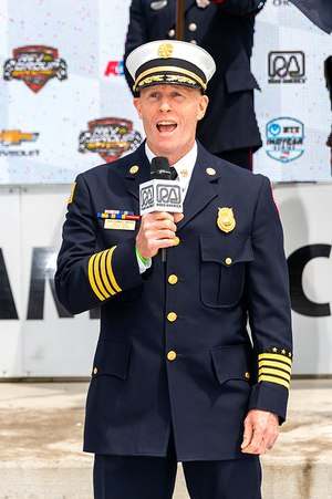 Battalion Chief Christopher Snyder of the Milwaukee Fire Department sang the National Anthem. (Photo/Les Tension)