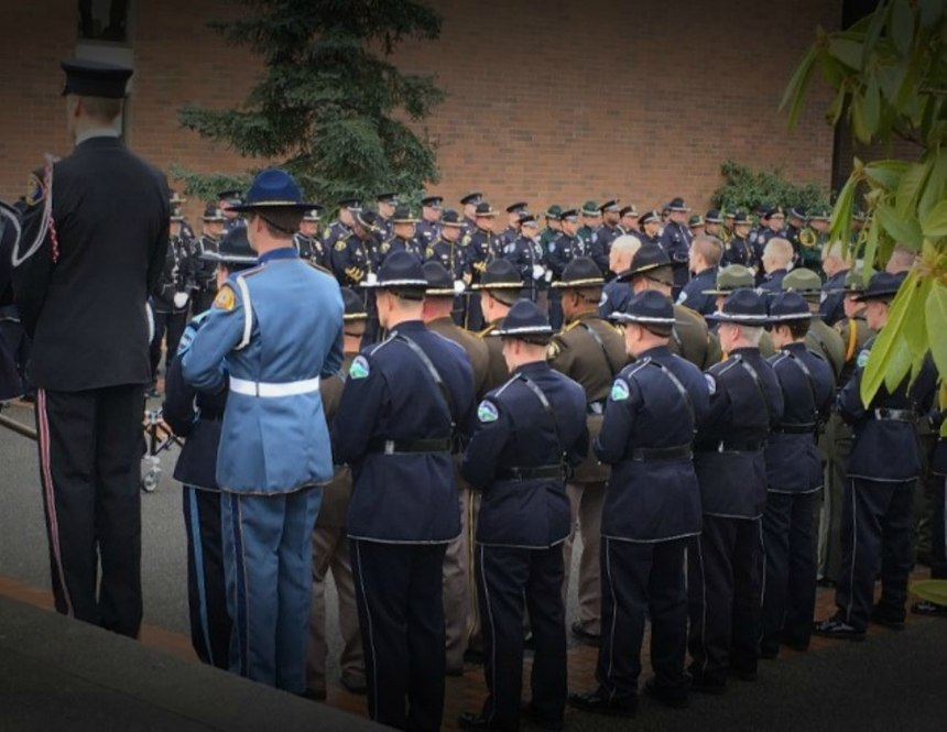 Being part of a memorial service is a sacred and heavy burden to bear for those who wear the Honor Guard uniforms.