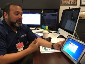 Dr. Michael Gonzalez demonstrates the software that manages the Houston Fire Department's ETHAN telemedicine program.